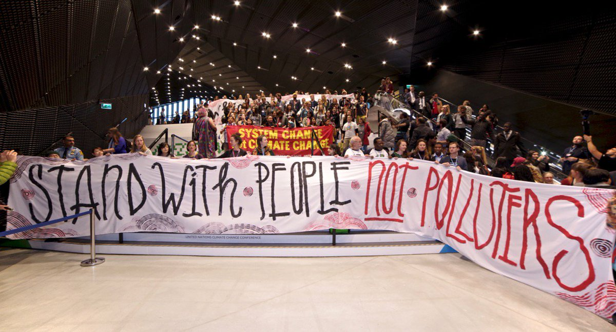 Massive civil society action at #COP24 we say stand with #peoplenotpolluters #ClimateJustice NOW!