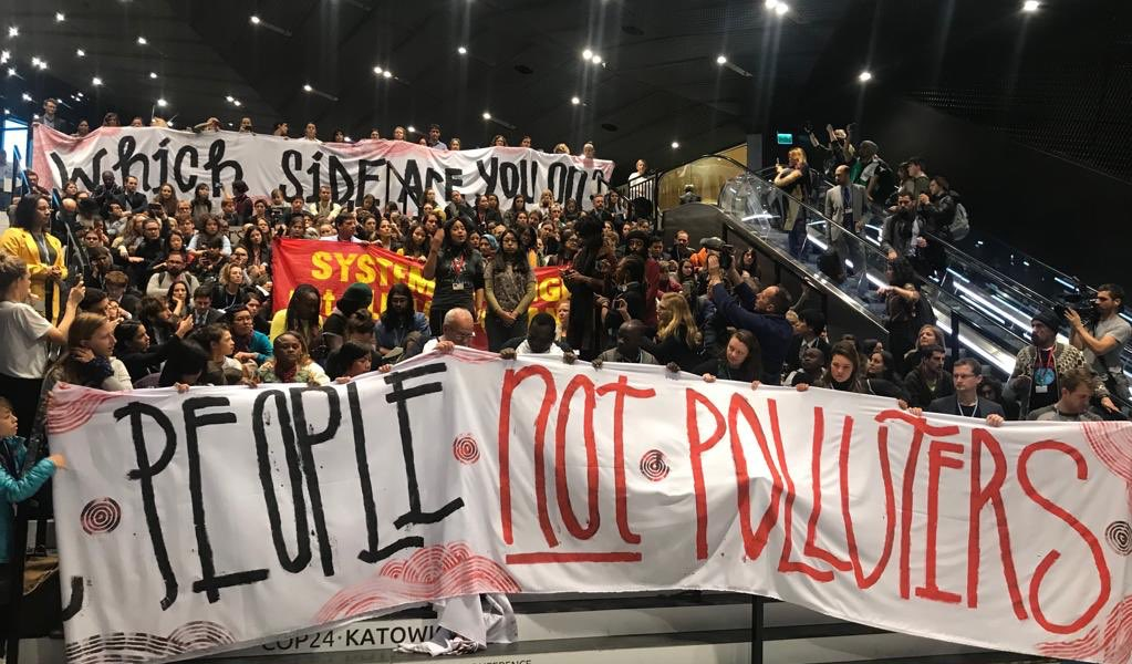 "Countries are failing to advance #climate justice at #COP24, so hundreds of us from movements of the world held a sit-in asking people and countries, ""which side are you on?"" We need a #JustTransition off fossil fuels. Now. JOIN US #peoplesdemands —> Peoplesdemands.org"