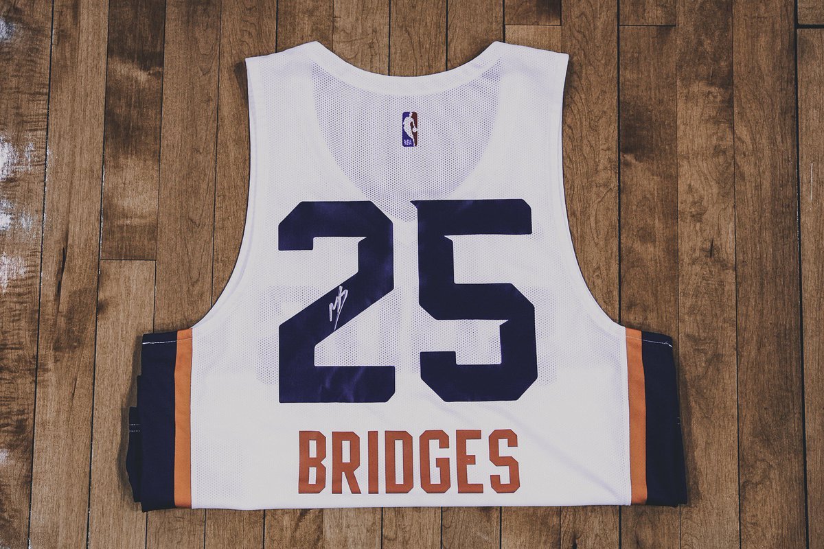 Day 2 of our #12DaysOfGiving!  RT for a chance to win an autographed Mikal Summer League jersey!