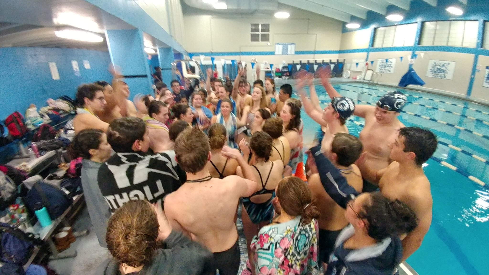 FHS swim team celebrates (via @coachB_fhs)