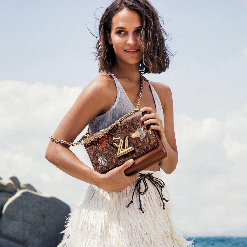 35612f820c14 a moment captured between takes alicia vikander carries a twist bag in  grace coddingtons catogram print