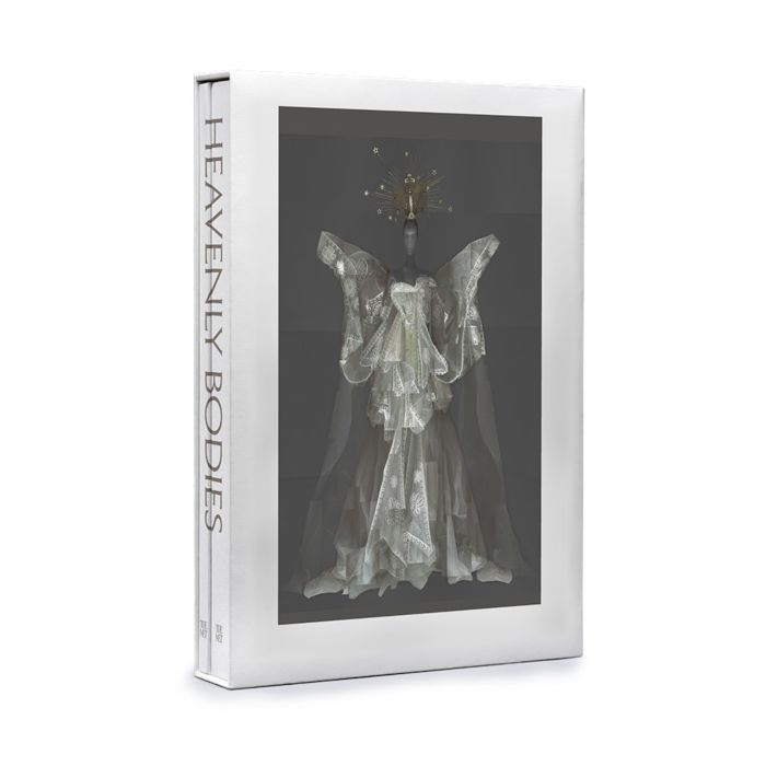 The stylish exhibition catalogue for #MetHeavenlyBodies makes @sfchronicle's list of  'top 2018 books to gift.' https://t.co/EkggGMmOuE