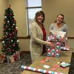 Image for the Tweet beginning: Staff wrapping gifts for families
