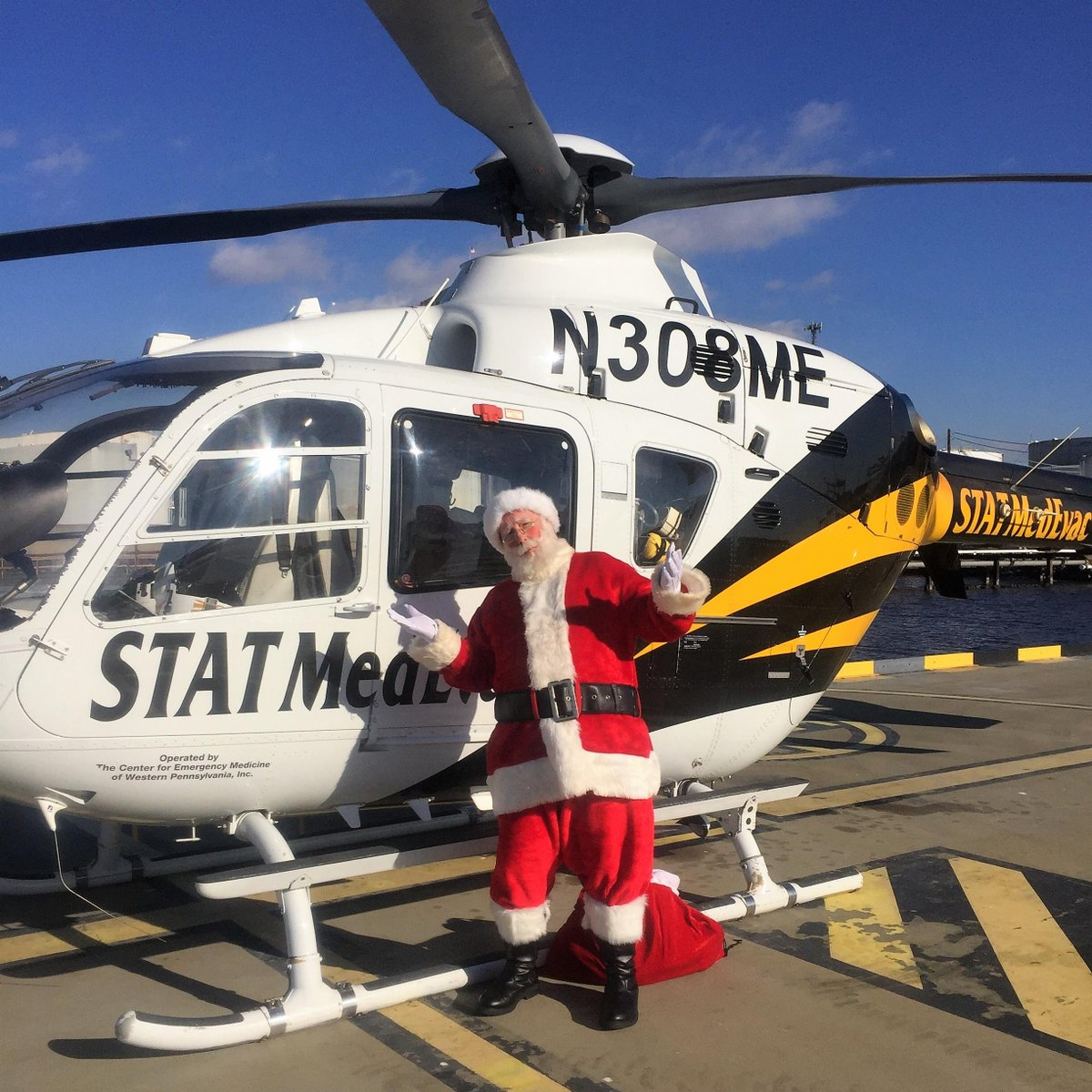 """c4c977a63c3 """"Up on the helipad A Helicopter lands Out jumps good ol  Santa Man"""