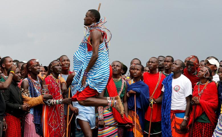 Tipape Lekatoo, a Maasai Moran from Mbirikani Manyatta, competes in a traditional high-jump event during the 2018 Maasai Olympics at the Sidai Oleng Wildlife Sanctuary, at the base of Mt. Kilimanjaro, near the Kenya-Tanzania border in Kimana, Kajiado, Kenya - Reuters/T. Mukoya