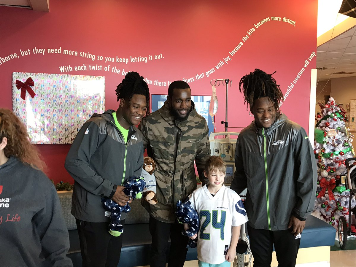 When #Seahawks  @Shaquemgriffin @ShaquillG and @KamChancellor make their way through Sacred Heart Children's Hospital in Spokane, you bet the kids come cheesin' for a photo.<br>http://pic.twitter.com/bgulm6N8Ox
