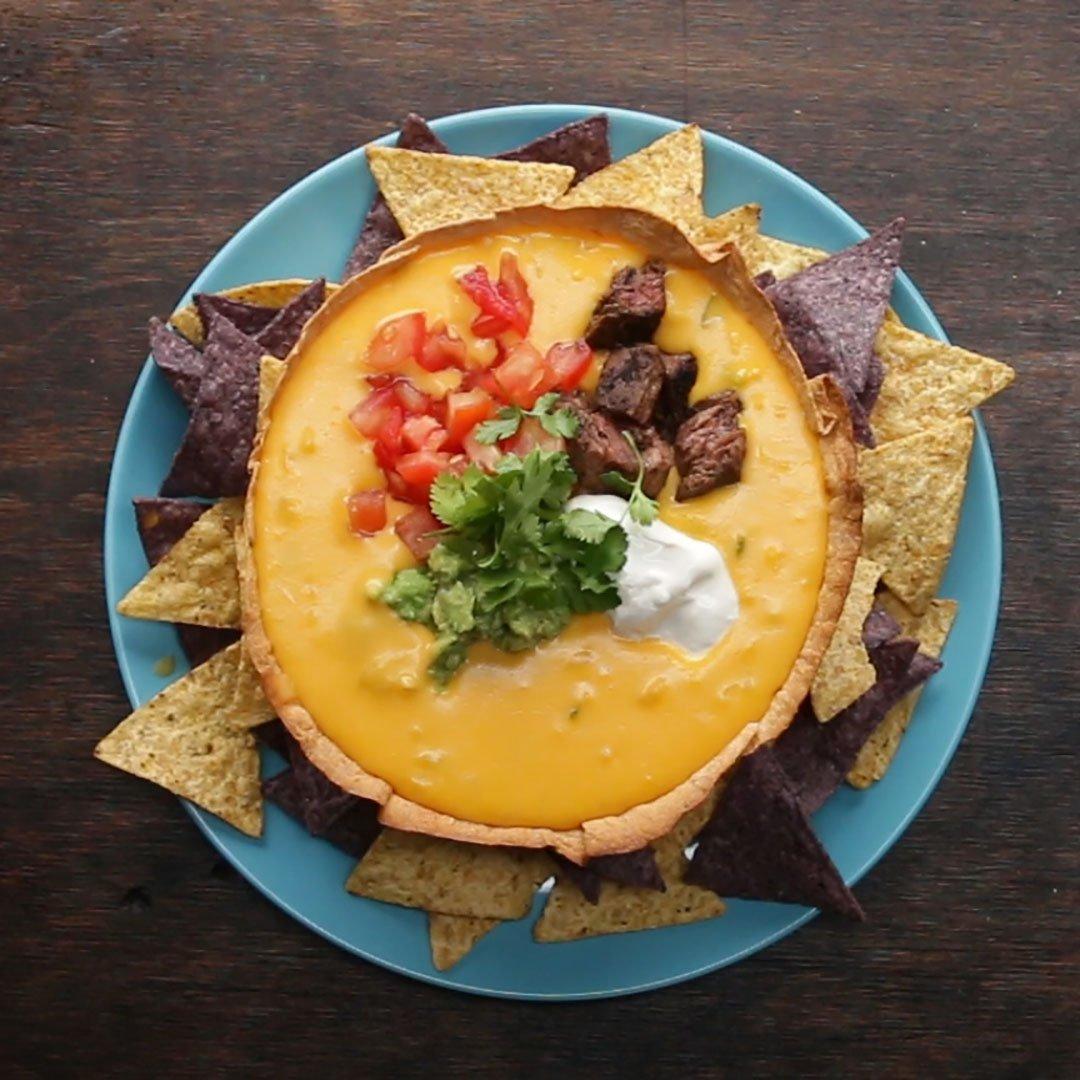 Goodbye nachos, hello queso in a tortilla bowl.