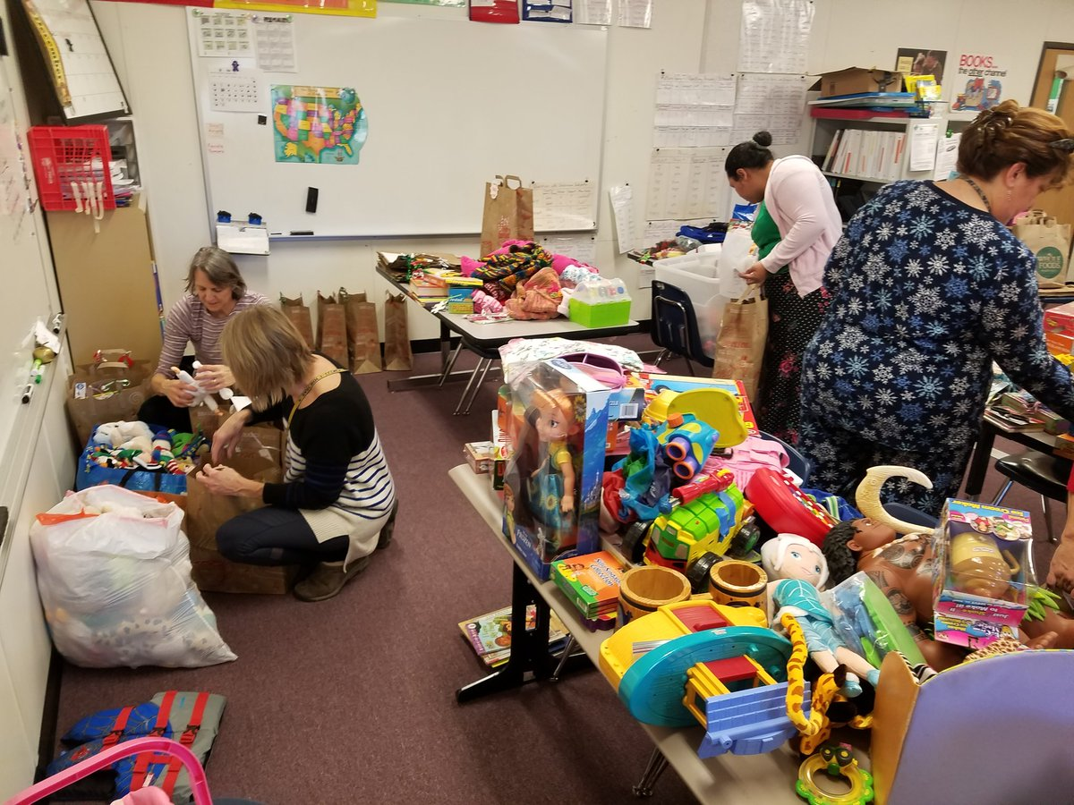 We are having a blast in our Santa's workshop. So many generous donations from the community! <a target='_blank' href='http://search.twitter.com/search?q=APSisAwesome'><a target='_blank' href='https://twitter.com/hashtag/APSisAwesome?src=hash'>#APSisAwesome</a></a> <a target='_blank' href='http://search.twitter.com/search?q=familyliteracy'><a target='_blank' href='https://twitter.com/hashtag/familyliteracy?src=hash'>#familyliteracy</a></a> <a target='_blank' href='http://twitter.com/GabyRivasAPS'>@GabyRivasAPS</a> <a target='_blank' href='http://twitter.com/BarcroftLibrary'>@BarcroftLibrary</a> <a target='_blank' href='http://twitter.com/APS_CTAE'>@APS_CTAE</a> <a target='_blank' href='http://twitter.com/BarbaraKanninen'>@BarbaraKanninen</a> <a target='_blank' href='https://t.co/8nyBw3vJKb'>https://t.co/8nyBw3vJKb</a>