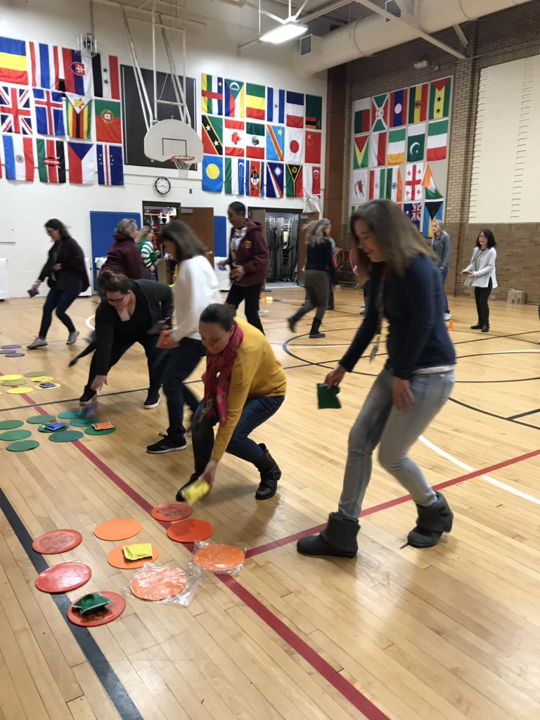 Staff @IPS_CFI #atPlay learning the games their students play in PE