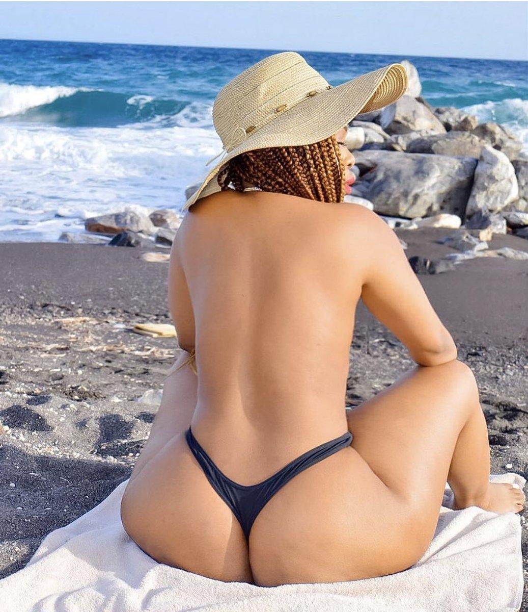 Emily ratajkowski slips on orange thong bikini in miami