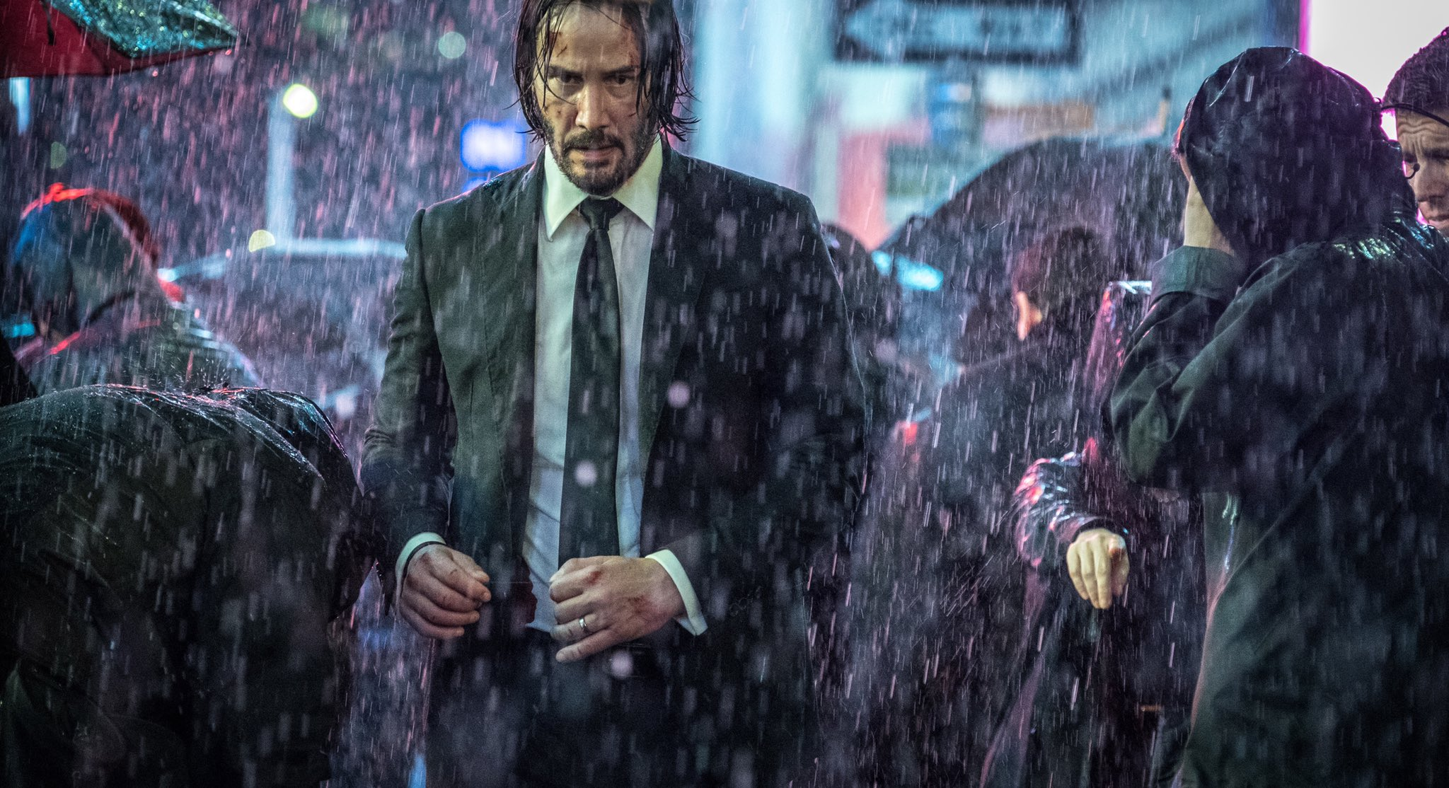 john wick chapter 3 official stills feature keanu reeves halle