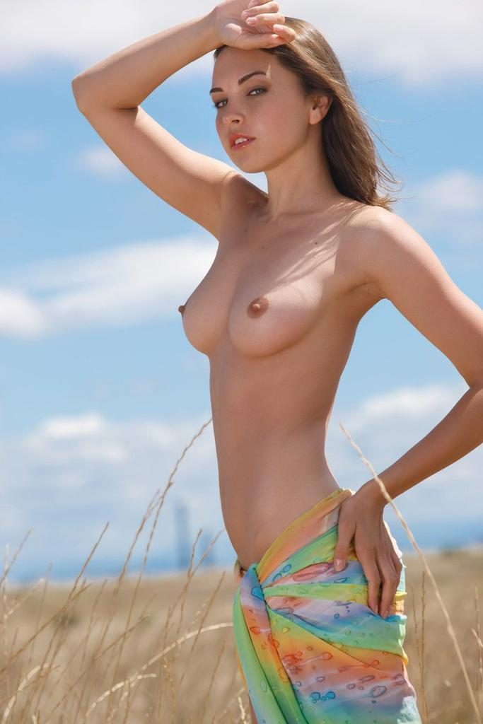 Portrait Of A Pretty Topless Girl With A Dark Hair Stock Photo