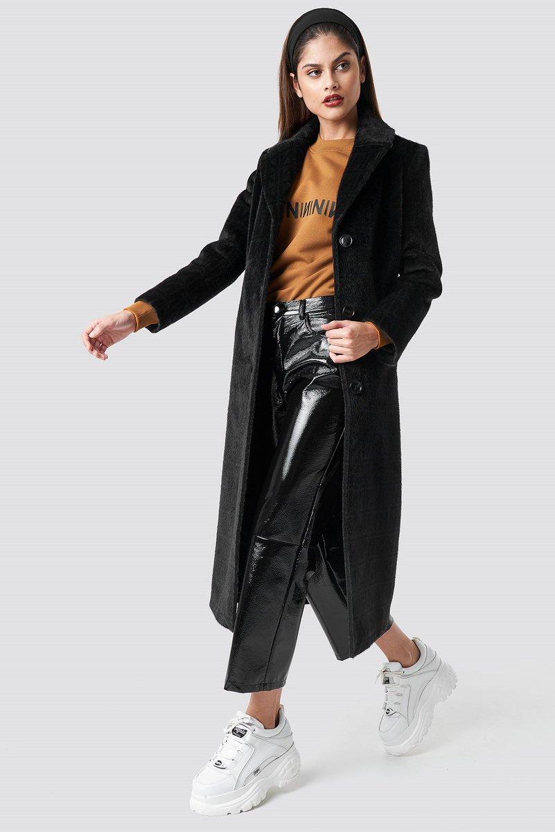Manteau a carreaux noir et blanc