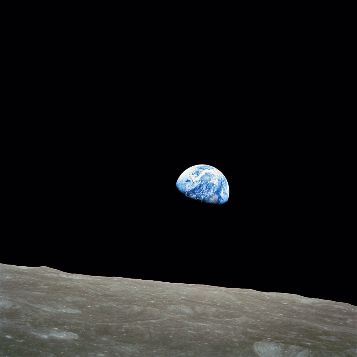 """""""Earthrise"""" was taken on Xmas 50 years ago (Anders, Apollo 8).  Looking at this pic it feels so dumb that people still fight for religions,  think skin color makes us unlike, or exploit the fragile nature.  Our blue planet is the """"miracle"""" that we all must cherish. #OneHumanRace"""