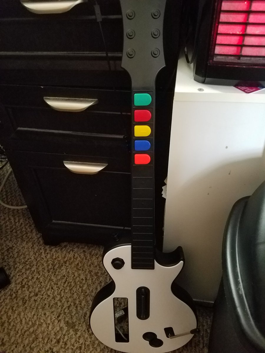 Finally got myself a guitar for clone hero and I cant wait to break