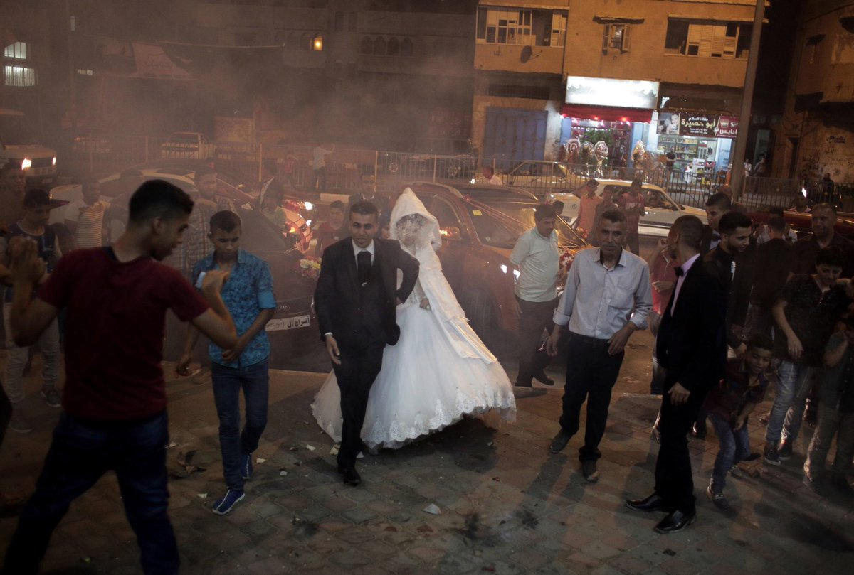 "This week we are sharing the most receptive visuals on the #visapourlimage IG! First is #khalilhamra image from his recently exhibited work ""Why Gaza?"" It shows a #wedding — a welcome celebration in what is often a bleak existence in the #Gaza Strip. #GazaCity, July 31, 2016."