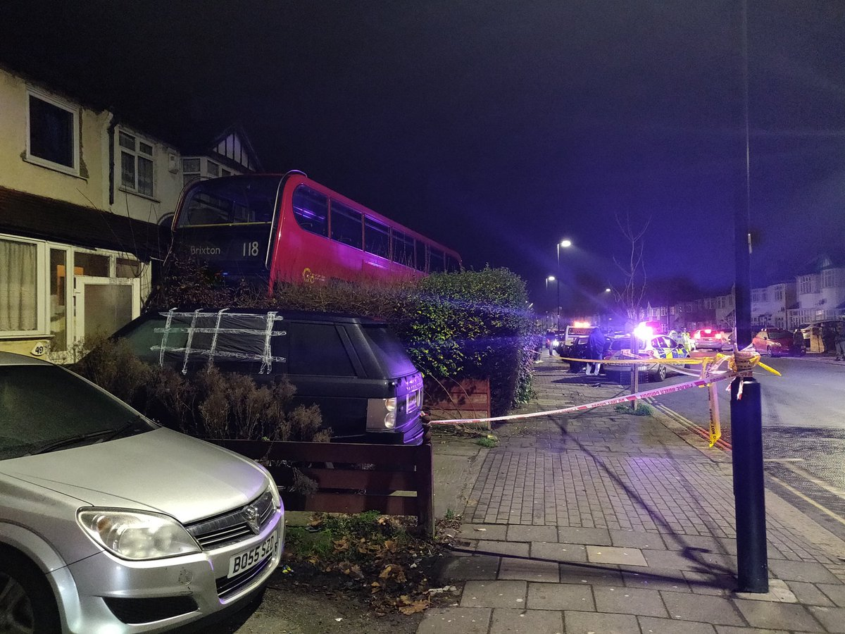 Double-decker bus smashes into garden of London home causing Boxing Day chaos