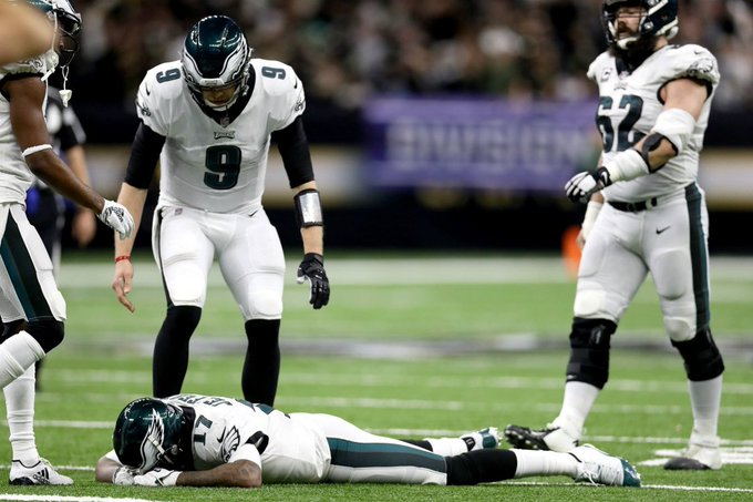 Now THIS is a photo. Lowest point of Alshon Jeffrey's season and maybe career, and his quarterback, Nick Foles, comes to pick him up. Amazing. Photo