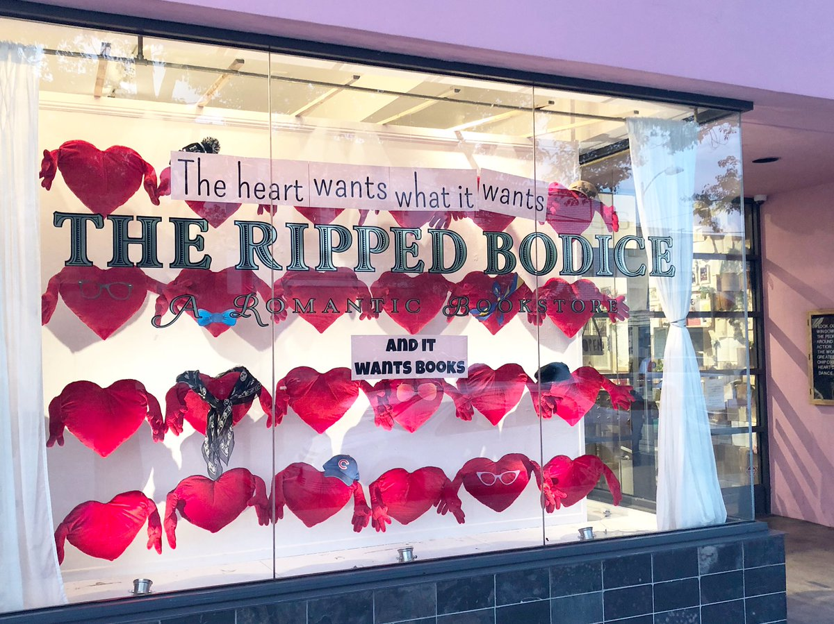 """de26b17b26796 Leah's Valentine's Day window display of hearts strung across in lines with  the words """"the"""