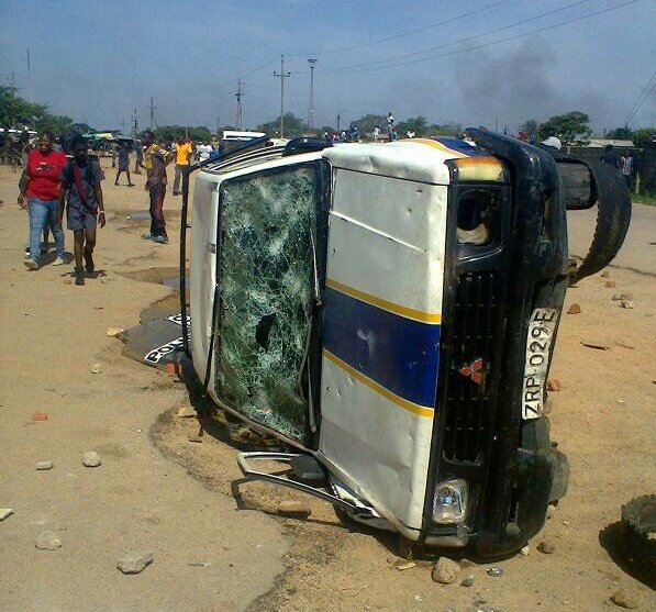 The police car which was overturned by rioters in Pumula. #shutdownZimbabwe #Asakhe Photo