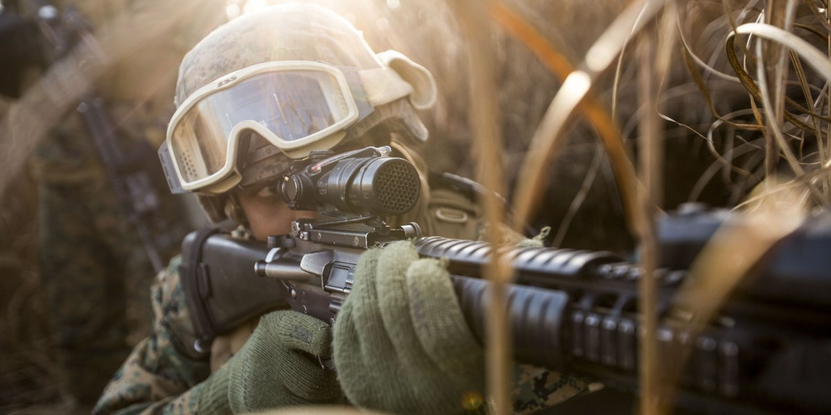 Sight In  A Marine with 3rd Marine Division patrols while conducting 'Reconnaissance and Selection of Position' training at the Combat Arms Training Center on Camp Fuji, Japan.