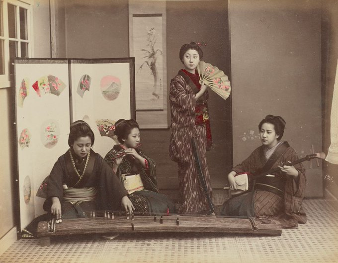 Three of these four women are playing musical instruments while one stands holding an open fan! Created in Japan by Kusakabe Kimbei, this hand-colored albumen silver print was captured around 1870–1890. #MusicMonday Photo