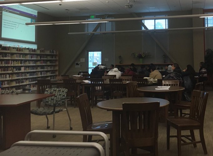 "At Méndez High School, a handful of seniors gathered at library watch a presentation on ""Three Economic Questions"" 📸 by @carmxngonzalxz #LAUSDStrike #BoyleHeights Photo"