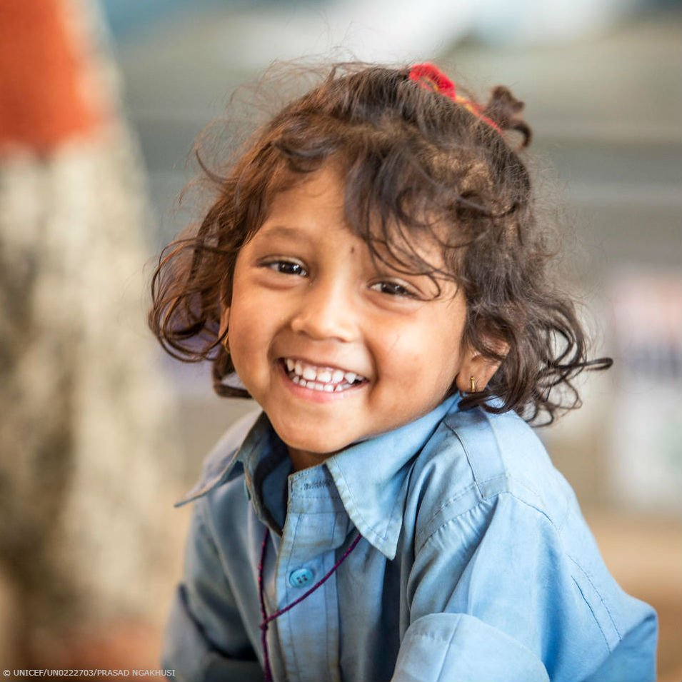 Nibina is all smiles at her school in Nepal. #ForEveryChild, 😄📚✏️