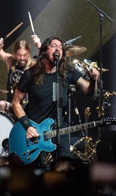 Yesterday was Dave Grohl's 50th birthday. Disappointed I wasn't invited to the party, but I'll post this pic of Dave anyway and also a pic of my dog Hershel eating ice cream. Happy belated 50th, Dave! Photo