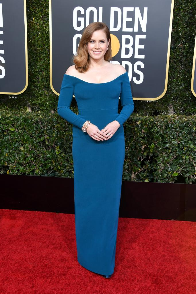 Triple nominee #AmyAdams stuns in a custom CALVIN KLEIN BY APPOINTMENT teal silk crepe dress for tonight's #GoldenGlobes #redcarpet.