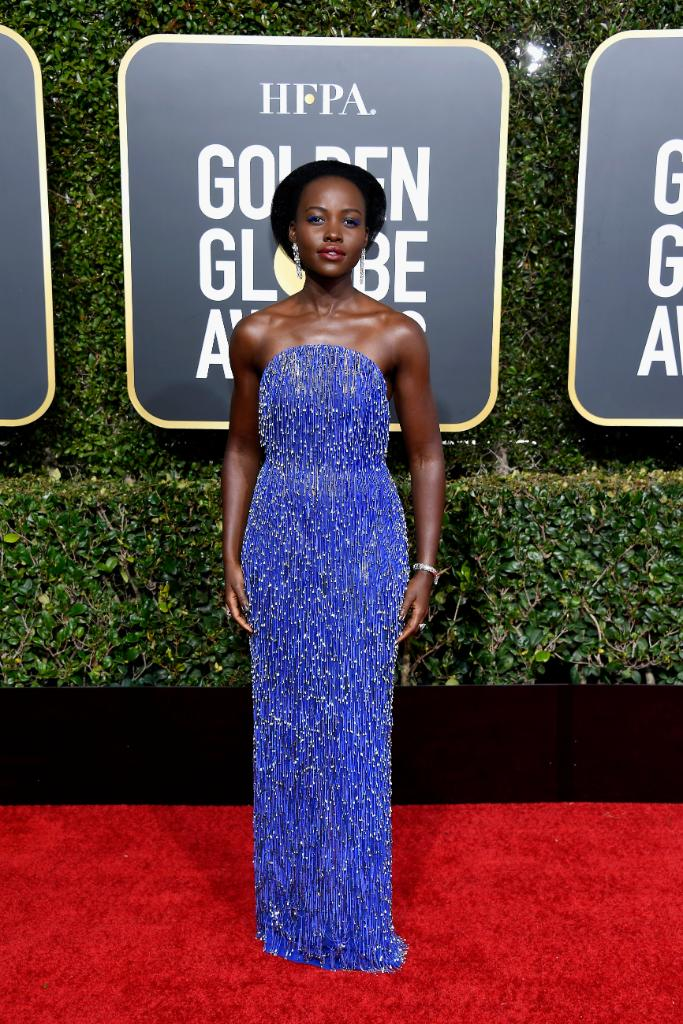 Tonight's #GoldenGlobes Presenter and #BlackPanther star @Lupita_Nyongo glows in a custom CALVIN KLEIN BY APPOINTMENT cobalt blue chain fringed dress with silver drop beads. #CKBA