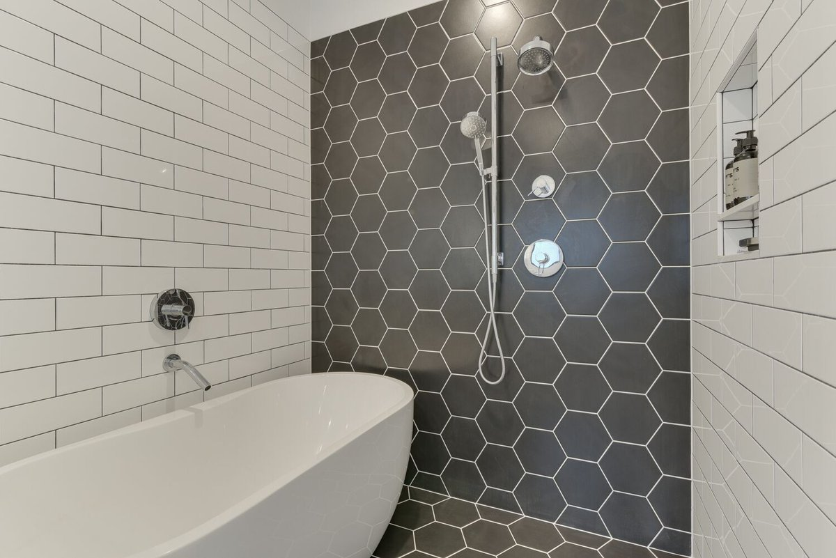 We are loving the way this modern tile look came together. Mixing different shapes turned out beautiful. Hexagon tile from #modernsurfacesnw and subway tile from @emsertile.  . . . . #letsremodelpdx #pdx #design #tilework #bathroomremodel #hexagontile #blackandwhitetile