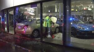 Security officer detains man who intentionally crashed into Porsche dealership