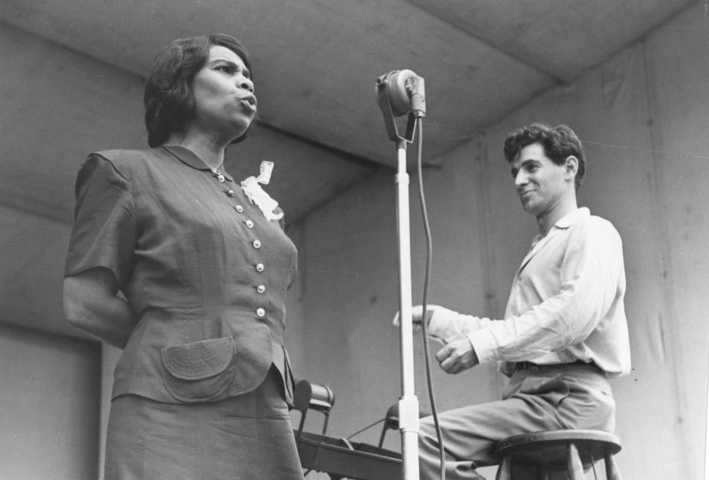 Contralto Marian Anderson Stands Singing On The Lewisohn Stadium Stage As Leonard Bernstein Sits A