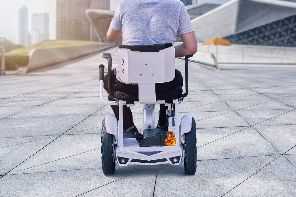 Don't let mobility challenges stop you from doing the things you enjoy doing. Airwheel H3S automatic visual following chair will help people with reduced mobility. #wheels #wheelchair #powerchair #following #electric #smart #robot #robotics #rideout #power #airwheel #scooter
