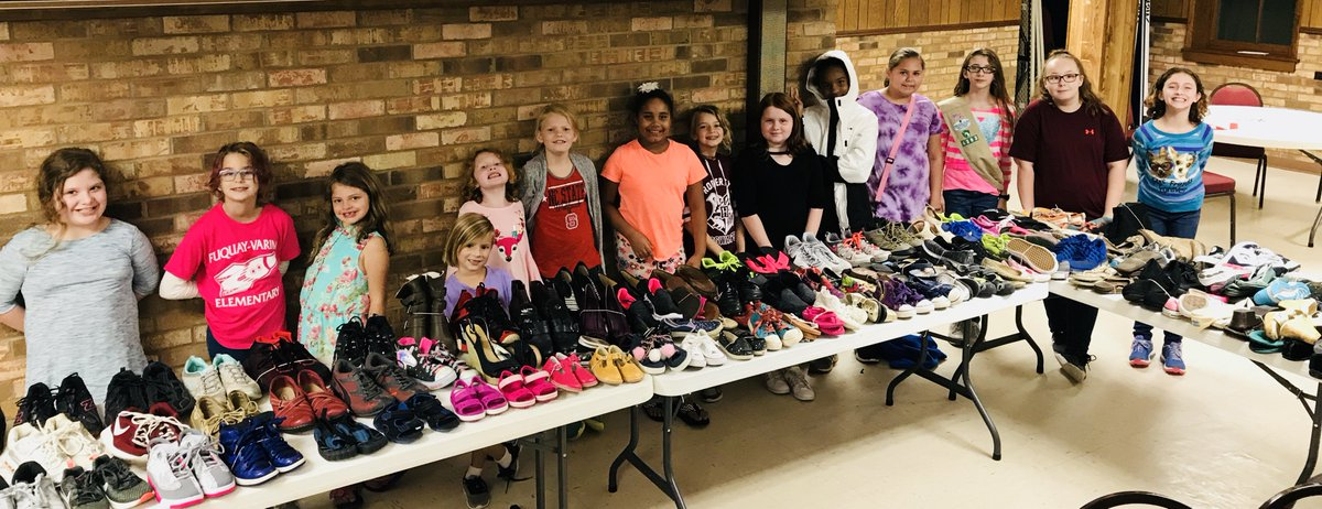 Girl Scout Troop #4393 collected over 150 pairs of shoes for