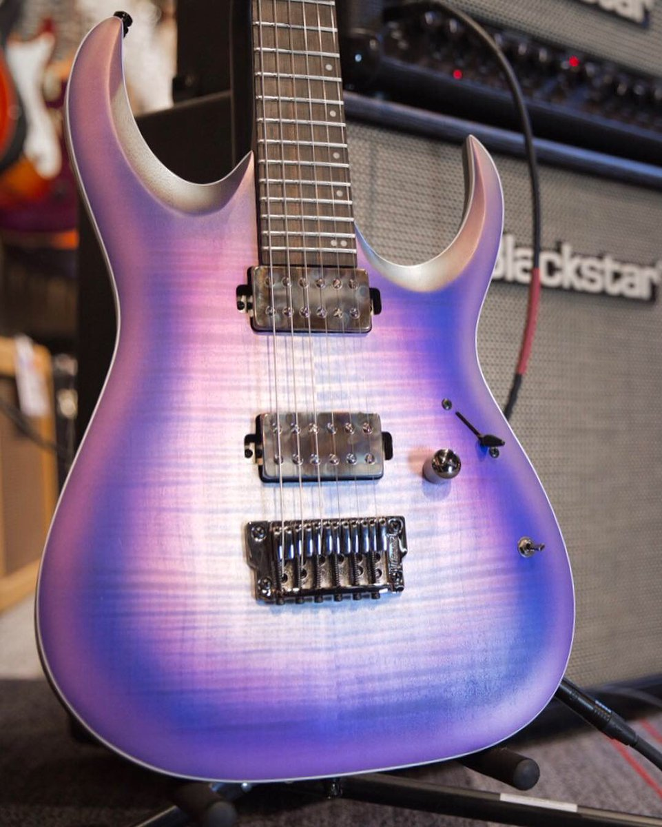 Ready for Axion 🔥 The @ibanezofficial RGA61AL in Indigo Aurora Burst features a Macassar Ebony fretboard, ultra-playable Nitro Wizard 5-piece Panga Panga/Walnut neck + Bare Knuckle Aftermath pickups (with coil-tap): https://t.co/hJ2Q5KdnNe