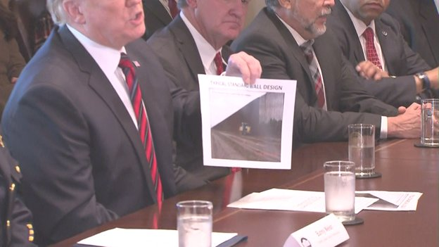 Pres holds up photo of the wall he wants along southern border that allows law enforcement to see through to the other side, giving them a better understanding of the threat.