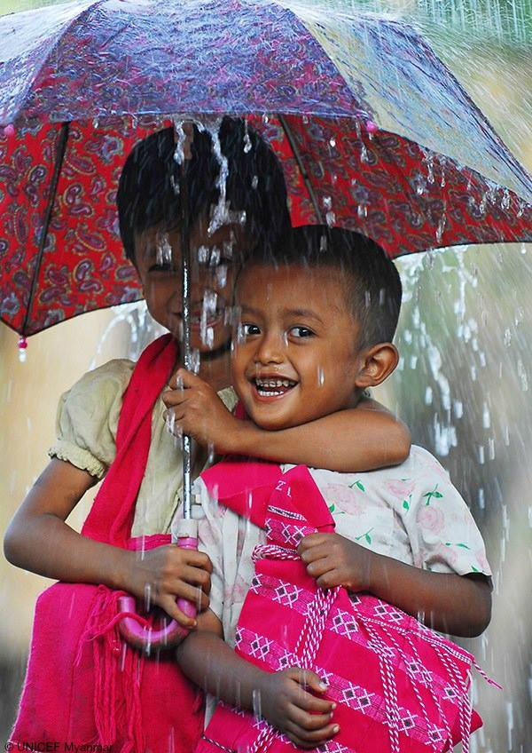 Rain or shine, help a friend!  Take a cue from these school children in Myanmar 😄😀. #ForEveryChild