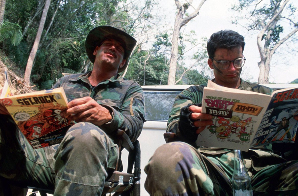 Behind the scenes at Predator - Jesse Ventura and Shane Black taking a breather and catching up on some reading   #FBF #flashbackfriday #Predator #80s
