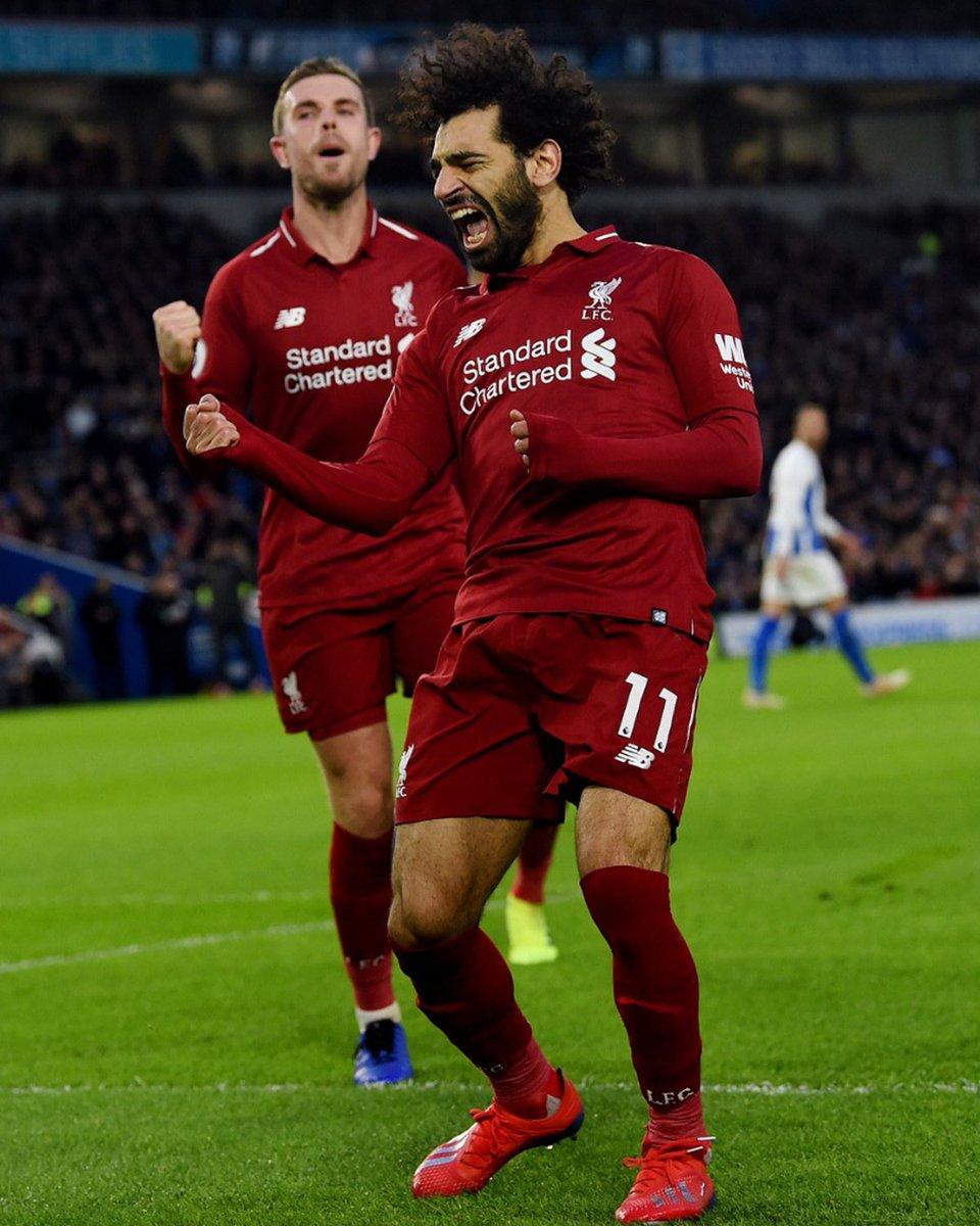 Pemain Liverpool, Mohamed Salah melakukan selebrasi usai berhasil mengeksekusi tendangan penalti ke Brighton and Hove Albion pada lanjutan Liga Inggris 2018-2019, Sabtu (12/1/2019).