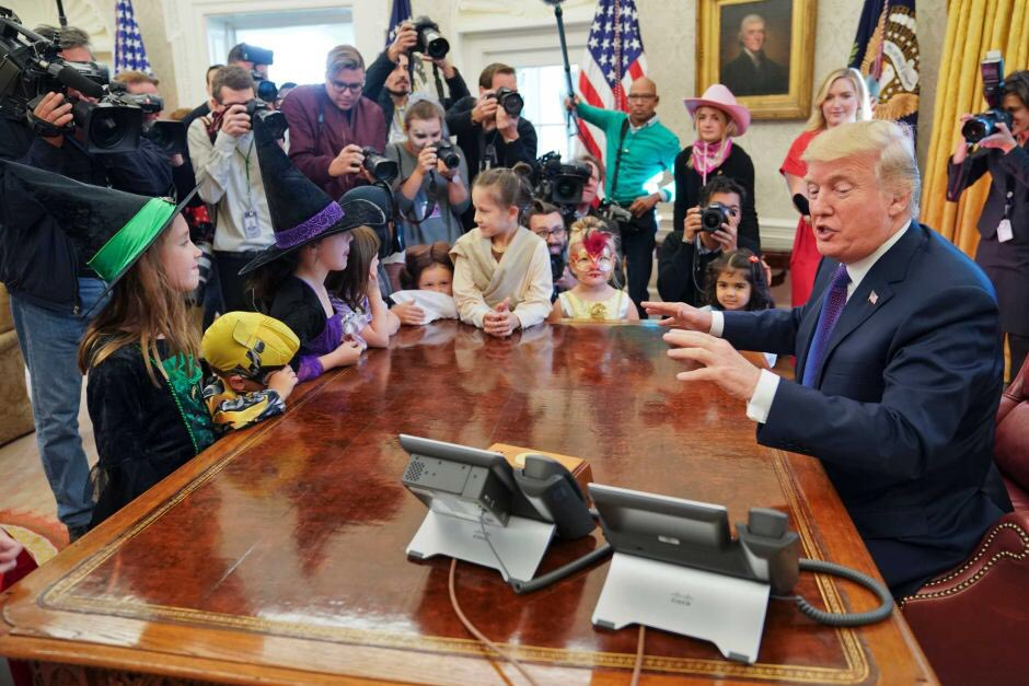 US President Donald Trump seen meeting with Social Media Posting Team, in undated photo.