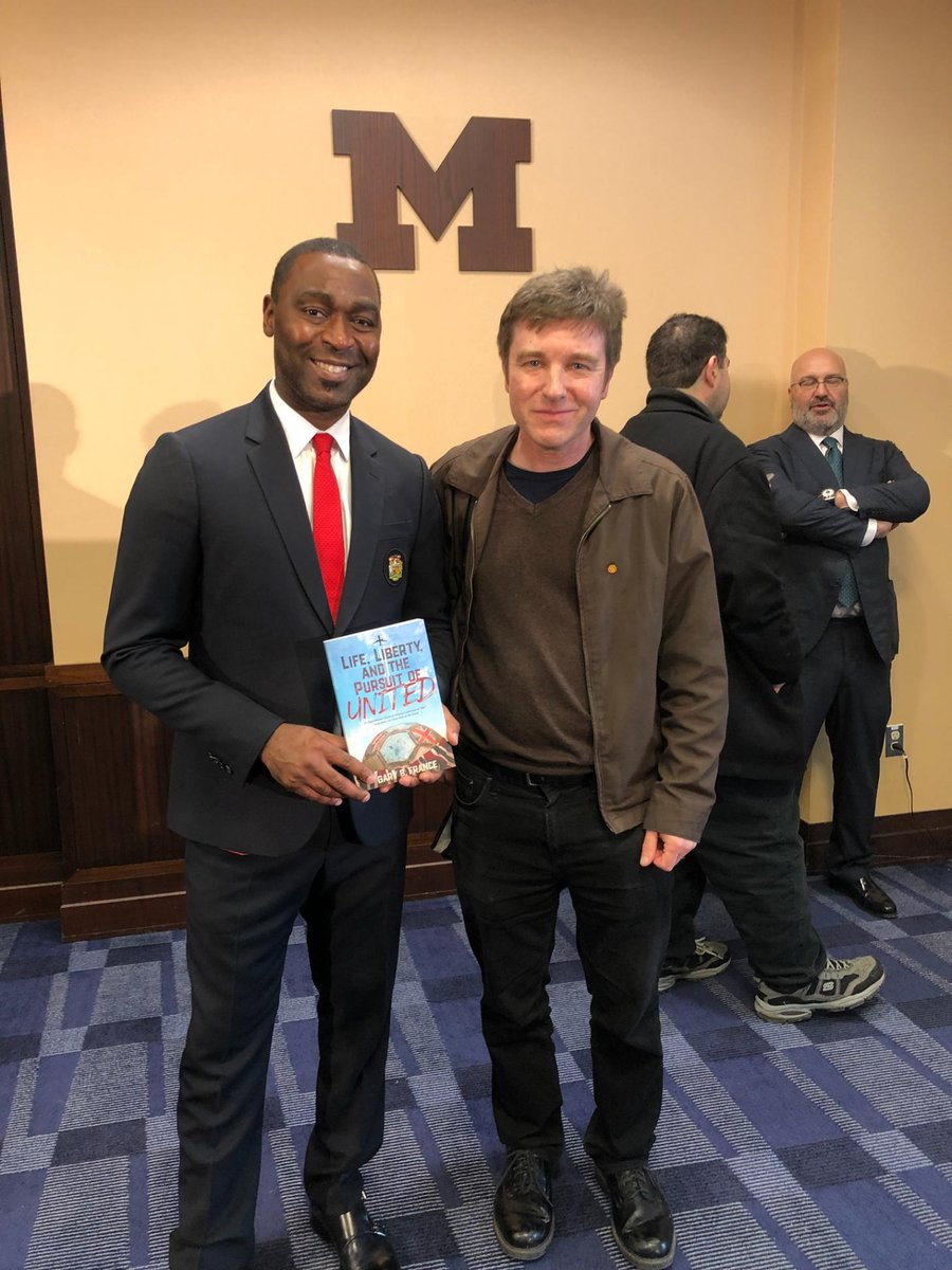 "Great picture mate 👏👏 ""Thanks"" for sharing. Ask Andrew if he's red my book yet 😉 I love this pic of him with my Publisher Jon at the U of M stadium Ann Arbor 🇺🇸 promoting Ut'd v Pool match.  ""Keep on doin it"" Andy 👍 Can't wait for tomorrow @manutd v Spurs 💪 'Forever United'"