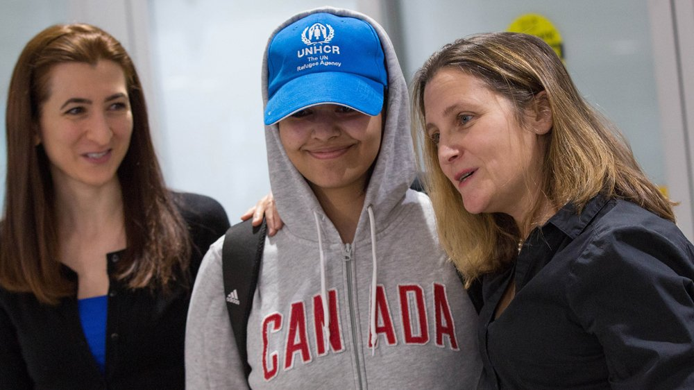 Saudi teenager Rahaf Mohammed Alqunun is welcomed by Canadian Minister for Foreign Affairs Chrystia Freeland (R) as she arrives at Pearson International airport in Toronto http://aje.io/pgw4y