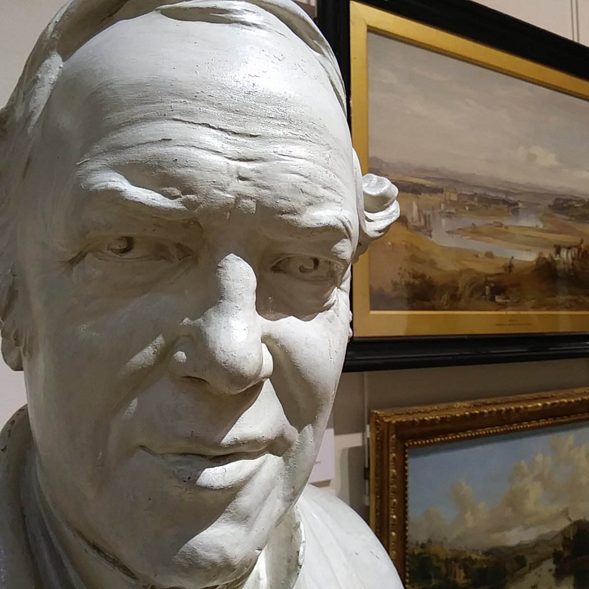 Picture of bust in front of paintings Perth Museum