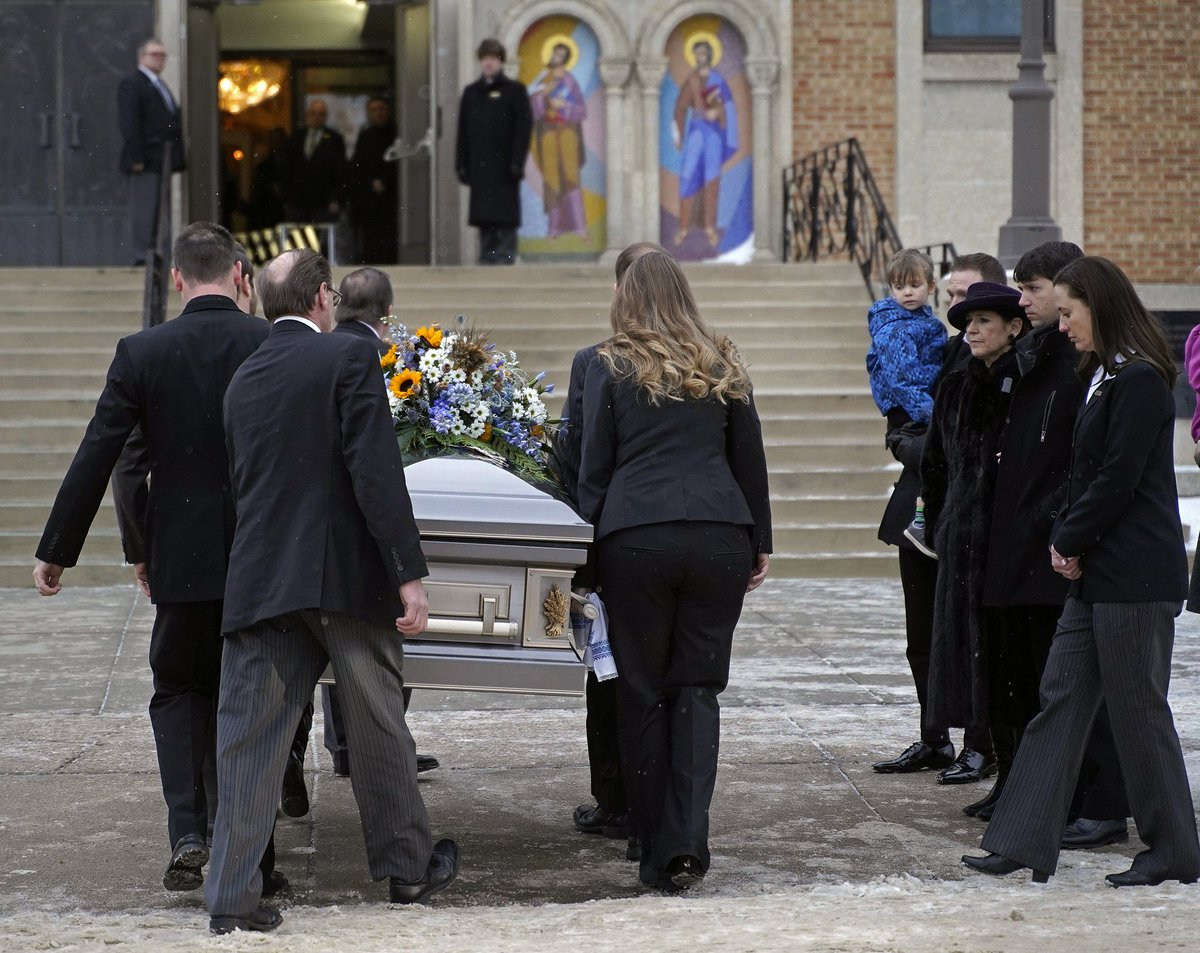 The family of Gene Zwozdesky (right) stand outside the Ukrainian Orthodox Cathedral of St. John in Edmonton where a funeral service was held this morning. The former Speaker of the Alberta Legislature and long-time politician died Sunday January 6, 2019 at the age of 70.  #ableg