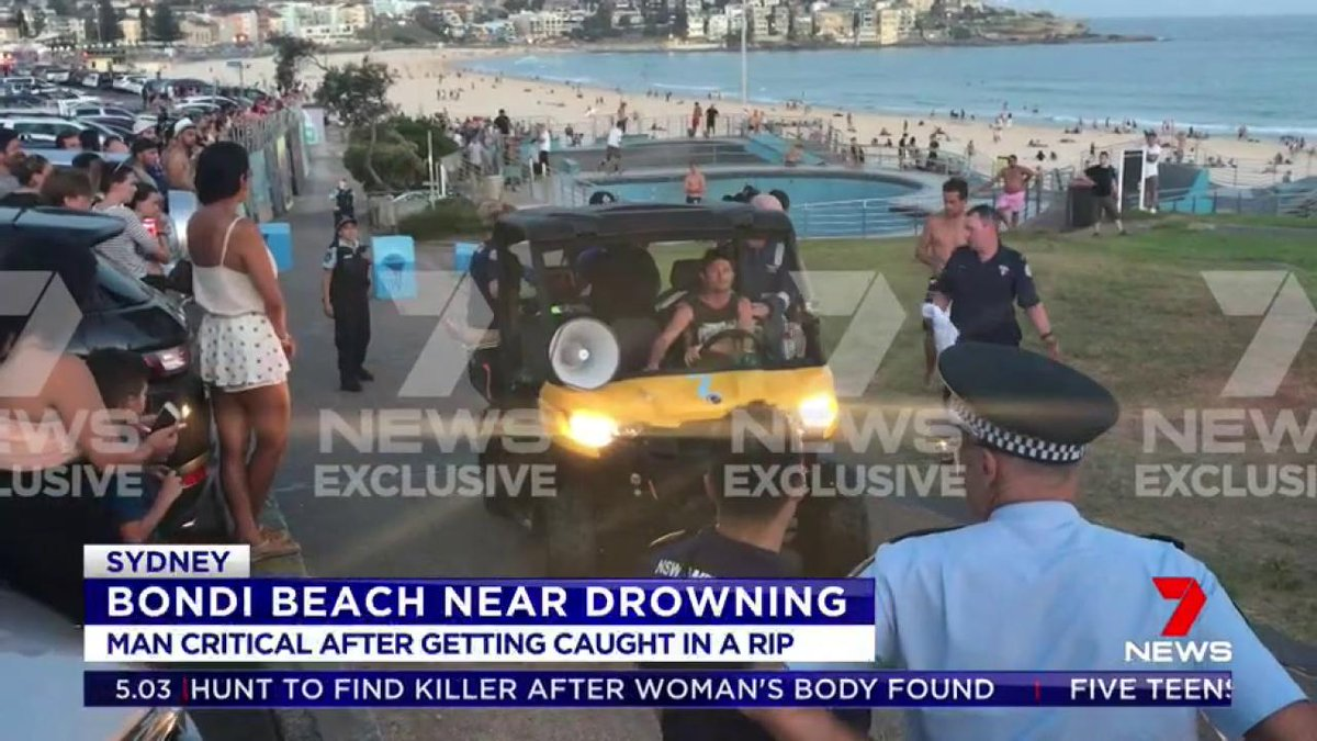 A man is fighting for life after nearly drowning in a rip off Bondi Beach. The 24-year-old was pulled from the water along with two of his mates. Paramedics say he was in cardiac arrest while being loaded into the ambulance. #Bondi #7News