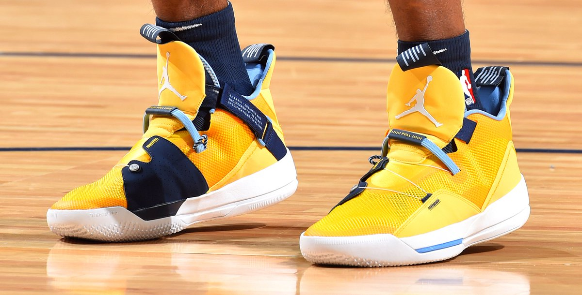 7a85e53ee47d mconley11 is hard to miss on the court in these bright yellow air jordan 33  pes