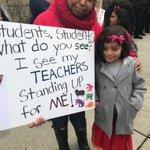 Telfair kindergarten student Alice gives sign to teacher Rita Ontiveros, who once was a Telfair student herself