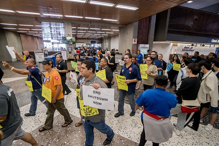 """Scenes from this morning's """"silent march"""" at the airport in support of federal employees who aren't getting paid during the partial government shutdown.  READ HERE: http://bit.ly/2RXWb1e  (Photos by Dennis Oda)"""